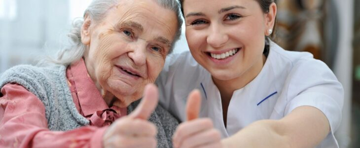 a senior and a long distant caregiving aid giving the thumbs up